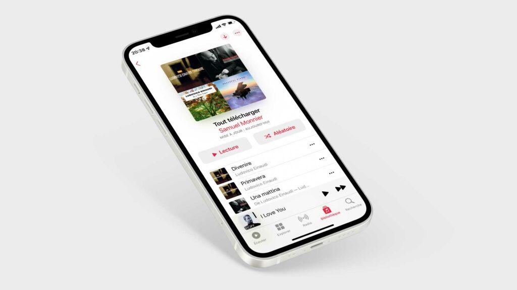 """Un iPhone affiche une playlist """"Tout télécharger"""" sur l'application Musique."""